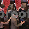 """MIKE SPRINGER/Staff photo<br /> Parishioners stand in the aisle for the """"laying on of hands"""" during Andover native Andrew Lloyd Harris's ordination Sunday as a minister in the United Church of Christ at South Church in Andover.<br /> 11/10/2019"""