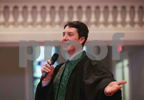 MIKE SPRINGER/Staff photo<br /> Rev. Andrew Lloyd Harris gives the benediction, his first as a clergyman, to close his ordination ceremony Sunday at the United Church of Christ at South Church in Andover. Harris, 29, is an Andover native and a 2008 graduate of Andover High School. He earned a Masters of Divinity from Andover Newton Theological School and will be posted to the Acton Congregational Church.<br /> 11/10/2019