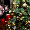CARL RUSSO/Staff photo. Dan Ward of Andover shows the Christmas tree to his daughters, Evie, 2 and Aiyla, 4 at the Holly Ball.  <br /> <br /> The annual holiday Holly Ball dance sponsored by Andover Recreation was held Friday night (11/22) at the the Old Town Hall. (Town House) Little girls wearing their special holiday dresses were escorted by their fathers or Grandfathers or uncles. Mike Pride entertainment provided the music and games while refreshments were served. 11/22/2019