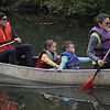 MIKE SPRINGER/Staff photo<br /> Chris and Taylor Sullivan of Andover paddle a canoe with their children Selby, 7, and Dylan, 5, during the 2nd Annual Andover Scramble on Sunday. <br /> 10/06/2019