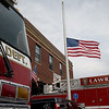 TIM JEAN/Staff photo<br /> <br /> The U.S. flag flying at half-mast in memory of those who died after the annual 9/11 memorial ceremony at the Ladder 4 Fire Station in Lawrence.   9/11/19