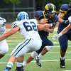 CARL RUSSO/Staff photo Joshua Ramos attempts to squeeze in between Wayne Valley defenders. The Andover Warriors were defeated 31-12 by the Wayne Valley Indians of New Jersey in a non conference football game Friday afternoon. 9/6/2019