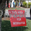 MIKE SPRINGER/Staff photo<br /> A sign tells visitors to the 2019 Greek Festival at Sts. Constantine and Helen Greek Orthodox Church in Andover on Sunday that the area has been sprayed for mosquitos. <br /> 9/8/2019