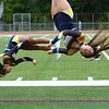 CARL RUSSO/Staff photo High flying Andover cheerleaders, freshman Shaylze Garcia, left and sophomore Colleen Carzo somersault down the sideline during Andover's first home football game of the season.  <br /> <br /> The Andover Warriors were defeated 31-12 by the Wayne Valley Indians of New Jersey in a non conference football game Friday afternoon. 9/6/2019