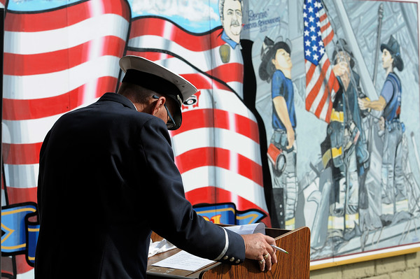 TIM JEAN/Staff photo<br /> <br /> Lawrence Fire Lt. Jimmy Flynn bows his head to remember those who died in the line of duty during the annual 9/11 memorial ceremony at the Ladder 4 Fire Station in Lawrence.   9/11/19