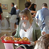 MIKE SPRINGER/Staff photo<br /> Maria Giannakopoulos of Andover serves loukomades, a traditional Greek dessert, during the annual Greek Festival on Sunday at Sts. Constantine and Helen Greek Orthodox Church in Andover. <br /> 9/8/2019