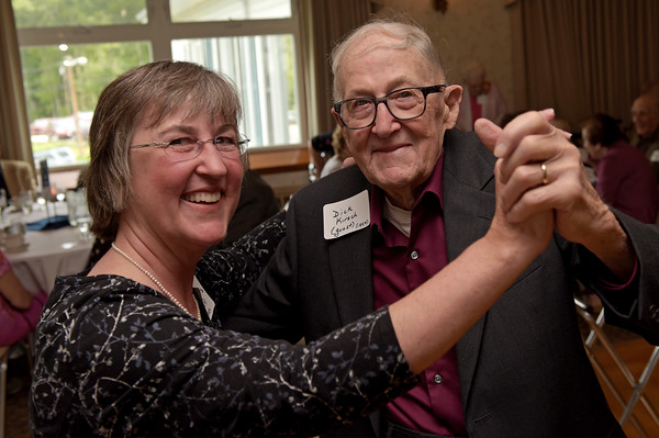 TIM JEAN/Staff photo<br /> <br /> Linda Desrochers, of Derry, dancers with her father Richard Kirsch, of Chelsmford, and guest class of '54 during a Methuen High School class of 1938-1956 reunion luncheon at Harris' Pelham Inn.  9/11/19