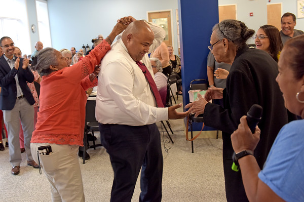 TIM JEAN/Staff photo<br /> <br /> Lawrence Mayor Daniel Rivera, center, dances with residents at the Mi Casa Adult Day Health Center on Broadway during a stop, as they ride the bus to promote that its free. The City of Lawrence is paying the MVRTA to run three free bus routes within the city, for the next two years.    9/10/19