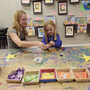 TIM JEAN/Staff photo<br /> <br /> Lindsey Pimentel, of Andover, and her daughter Avery, 5, make some art in the Kidcasso Art Studio, after a ribbon cutting ceremony for the redevelopment project for the Draper Block in downtown Andover.   9/26/19