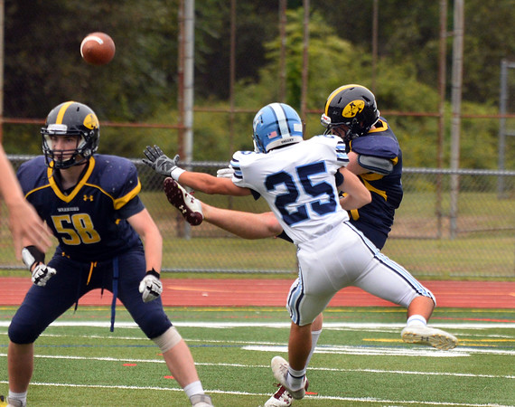 CARL RUSSO/Staff photo Andover captain, Shamus Florio gets his punt away just in time as the Wayne Valley defender charges in. The Andover Warriors were defeated 31-12 by the Wayne Valley Indians of New Jersey in a non conference football game Friday afternoon. 9/6/2019
