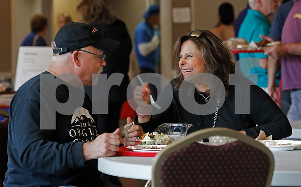 MIKE SPRINGER/Staff photo<br /> Christine and Frank Greeley of Methuen enjoy the food during the annual Greek Festival on Sunday at Sts. Constantine and Helen Greek Orthodox Church in Andover. <br /> 9/8/2019
