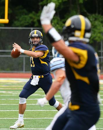 CARL RUSSO/Staff photo Andover's quarterback, Victor Harrington looks to make a pass to captain Michael Slayton. Slayton caught the pass by the sideline for the completion. <br /> <br /> The Andover Warriors were defeated 31-12 by the Wayne Valley Indians of New Jersey in a non conference football game Friday afternoon. 9/6/2019