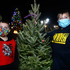 CARL RUSSO/staff photo. Teddy Crow, 9 and his brother, Patrick, 11, pick out a tree. Andover Youth Services has opened their annual Christmas tree lot, located next to the high school. <br /> <br /> Christmas trees, wreaths of all sizes as well as other decorations are for sale to help support the Andover Youth Services program. The trees were hand-picked, cut, packed and delivered by an enthusiastic group of Andover High school students who traveled to Canada.<br /> <br /> This year, three wreaths made by and autographed by Andover's Mike Yastrzemski, right fielder for the San Francisco Giants are being sold.12/01/2020