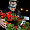 CARL RUSSO/staff photo. Andover Youth Services has opened their annual Christmas tree lot, located next to the high school. Andover Youth Services program coordinator, Tony Lombardi holds one of the wreaths made by and autographed by Andover's Mike Yastrzemski, right fielder for the San Francisco Giants.   <br /> <br /> Christmas trees, wreaths of all sizes as well as other decorations are for sale to help support the Andover Youth Services program. The trees were hand-picked, cut, packed and delivered by an enthusiastic group of Andover High school students who traveled to Canada.<br /> <br /> This year, three wreaths made by and autographed by Andover's Mike Yastrzemski, right fielder for the San Francisco Giants are being sold.12/01/2020