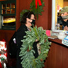 CARL RUSSO/staff photo. Andover Youth Services program coordinator, Tony Lombardi sells a wreath to Donna Coppola. Andover Youth Services has opened their annual Christmas tree lot, located next to the high school. <br /> <br /> Christmas trees, wreaths of all sizes as well as other decorations are for sale to help support the Andover Youth Services program. The trees were hand-picked, cut, packed and delivered by an enthusiastic group of Andover High school students who traveled to Canada.<br /> <br /> This year, three wreaths made by and autographed by Andover's Mike Yastrzemski, right fielder for the San Francisco Giants are being sold.12/01/2020