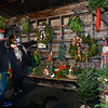 CARL RUSSO/staff photo. Sam and Lindsey Reeves look at a variety of Christmas decorations at the Andover Youth Services tree lot, located next to the high school. <br /> <br />  Christmas trees, wreaths of all sizes as well as other decorations are for sale to help support the Andover Youth Services program. The trees were hand-picked, cut, packed and delivered by an enthusiastic group of Andover High school students who traveled to Canada.<br /> <br /> This year, three wreaths made by and autographed by Andover's Mike Yastrzemski, right fielder for the San Francisco Giants are being sold.12/01/2020