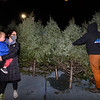 CARL RUSSO/staff photo. Misha Riley and her son, Asher Swatson, 3 watch as Megan Zalanskas, a Andover Youth Services Tree Lot volunteer for the last six years removes the tree they picked. Andover Youth Services has opened their annual Christmas tree lot, located next to the high school. <br /> <br /> Christmas trees, wreaths of all sizes as well as other decorations are for sale to help support the Andover Youth Services program. The trees were hand-picked, cut, packed and delivered by an enthusiastic group of Andover High school students who traveled to Canada.<br /> <br /> This year, three wreaths made by and autographed by Andover's Mike Yastrzemski, right fielder for the San Francisco Giants are being sold.12/01/2020