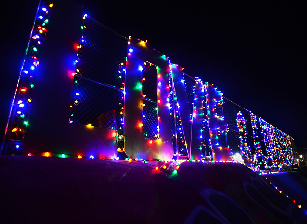 CARL RUSSO/staff photo. A sign spelling out the words Love and Kindness in colorful lights greets people entering the Andover Youth Services Christmas tree lot, located next to the high school. <br /> <br /> Christmas trees, wreaths of all sizes as well as other decorations are for sale to help support the Andover Youth Services program. The trees were hand-picked, cut, packed and delivered by an enthusiastic group of Andover High school students who traveled to Canada.<br /> <br /> This year, three wreaths made by and autographed by Andover's Mike Yastrzemski, right fielder for the San Francisco Giants are being sold.12/01/2020