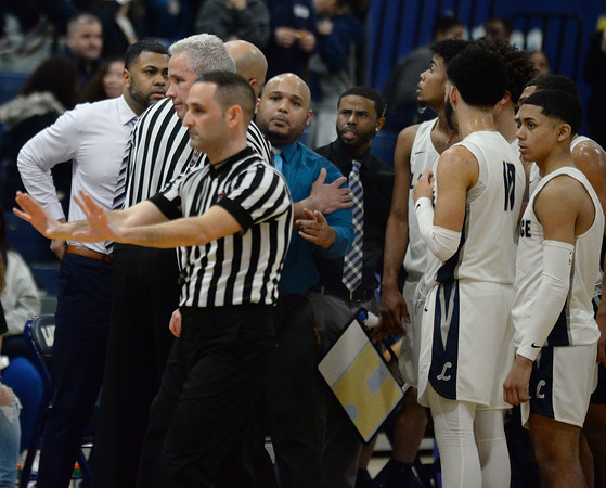 CARL RUSSO/Staff Photo Lawrence head coach, Jesus Moore talks to one of the officials. Officials had to keep the peace with the coaches early in the game. Lawrence defeated Andover 60-54 in boys Basketball action in the D1 North tournament. 2/25/2020