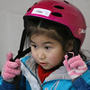 "MIKE SPRINGER/Staff photo<br /> Helen Yu fastens her helmet in preparation for an ""It's Great to Skate"" ice skating clinic Monday at Phillips Academy in Andover.<br /> 2/17/2020"