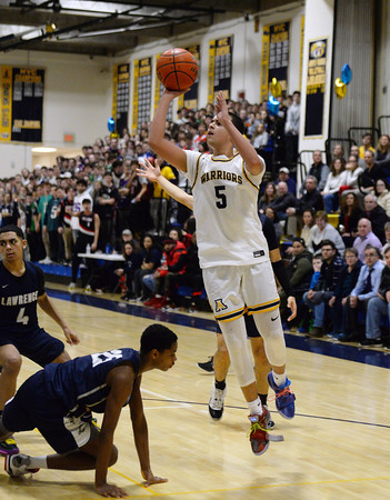 CARL RUSSO/Staff photo Andover captain, Kyle Rocker takes the short jump. Andover defeated Lawrence 66-57 in boys basketball action Friday night. 2/14/2020.