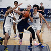CARL RUSSO/Staff Photo. Andover's captain, Kyle Rocker struggles to make the lay up against Lawrence's Cristian Moscat, left and Jeremiah Melendez. Lawrence defeated  Andover 60-54 in boys Basketball action in the D1 North tournament. 2/25/2020.