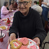 TIM JEAN/Staff photo <br /> <br /> Joan Fox, board member of the council on aging, offers up her Valentine's Day cookies she decorated at the Andover Senior Center. The center is temporary in the basement of the Ballardvale Church on Clark Road. 2/12/20