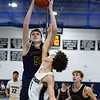 CARL RUSSO/Staff Photo. Lawrence's  Jeremiah  Melendez defends against Andover's Aidan Cammann <br /> <br />  as he takes the ball to the hoop. Lawrence defeated Andover 60-54 in boys Basketball action in the D1 North tournament. 2/25/2020