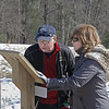 MIKE SPRINGER/Staff photo<br /> Barry Rich and Mary Iannuzzi of Devens look at a trail map while hiking during the Winter Fun Day on Feb. 17 at the Ward Reservation in Andover.<br /> 2/17/2020