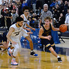 CARL RUSSO/Staff Photo. Andover's Ryan MacLellan comes up with the ball with Lawrence's captain, Angel Herrera, left and Jeremiah Melendez giving chase after a mad scramble for the loose ball. Lawrence defeated  Andover 60-54 in boys Basketball action in the D1 North tournament. 2/25/2020