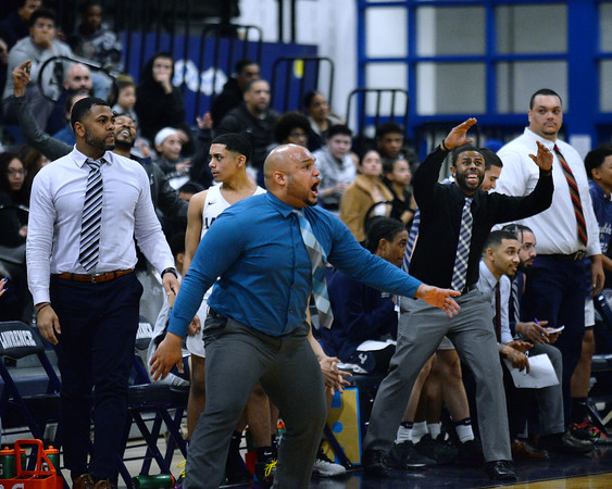 CARL RUSSO/Staff Photo Lawrence head coach, Jesus Moore yells for defense as the Lancers take the lead.  Lawrence defeated Andover 60-54 in boys Basketball action in the D1 North tournament. 2/25/20200.