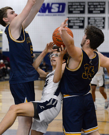 CARL RUSSO/Staff Photo. Lawrence's Jeremiah Melendez is fouled driving to the basket against Andover's Aidan Cammann and captain Michael Slayton. Lawrence defeated Andover 60-54 in boys Basketball action in the D1 North tournament. 2/25/2020.
