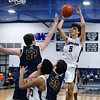 CARL RUSSO/Staff Photo. Lawrence's Jeremiah Melendez takes the jump shot over Andover's Aidan Cammann. Lawrence defeated Andover 60-54 in boys Basketball action in the D1 North tournament. 2/25/2020.