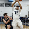 CARL RUSSO/Staff Photo. Andover's captain, Charlie McCarthy collides with Lawrence's captain Noah Tejada battling for the rebound. Lawrence defeated Andover 60-54 in boys Basketball action in the D1 North tournament. 2/25/2020.