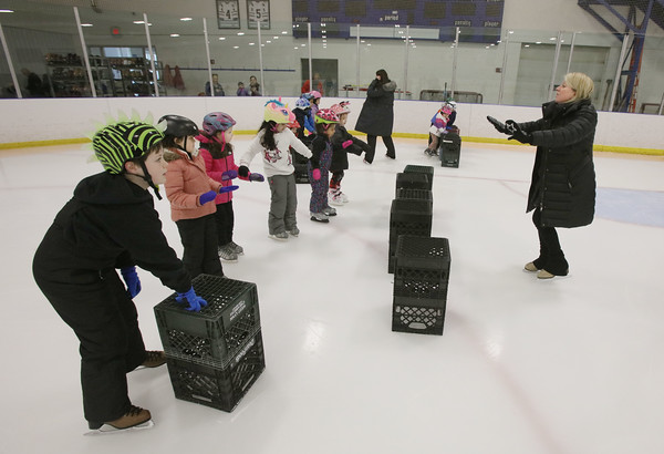 """MIKE SPRINGER/Staff photo<br /> Leslie Sharrio teaches a group of beginners during an """"It's Great to Skate"""" ice skating clinic Monday at Phillips Academy in Andover.<br /> 2/17/2020"""