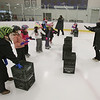 "MIKE SPRINGER/Staff photo<br /> Leslie Sharrio teaches a group of beginners during an ""It's Great to Skate"" ice skating clinic Monday at Phillips Academy in Andover.<br /> 2/17/2020"