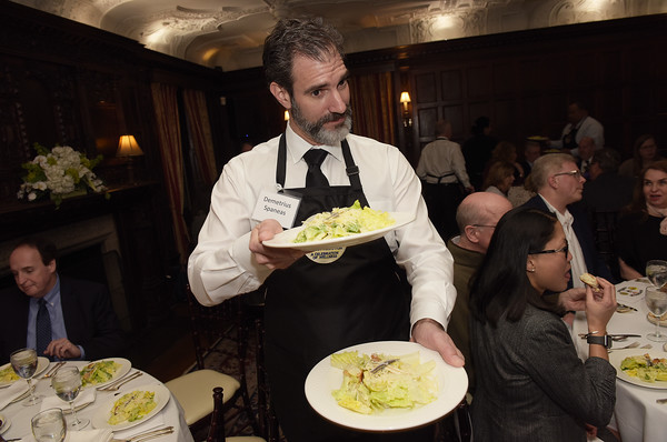 TIM JEAN/Staff photo <br /> <br /> Demetrius Spaneas, Land & Sea Real Estate and Andover Rotary Club President serves dinner as a Superstar Server and during the Andover Cares fundraiser at the LANAM club in Andover. 2/27/20