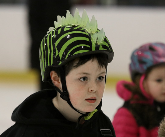 MIKE SPRINGER/Staff photo<br /> Eight-year-old Sam Reaich concentrates during an ice skating clinic Monday at Phillips Academy in Andover.<br /> 2/17/2020