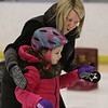 MIKE SPRINGER/Staff photo<br /> Instructor Leslie Sharrio helps five-year-old Whitney Heidorn during an ice skating clinic Monday at Phillips Academy in Andover.<br /> 2/17/2020