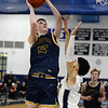 CARL RUSSO/Staff Photo. Lawrence's  captain, Angel Herrera defends against Andover's Aidan Cammann as he takes the ball the the hoop. Lawrence defeated Andover 60-54 in boys Basketball action in the D1 North tournament. 2/25/2020.