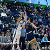 CARL RUSSO/Staff Photo. Lawrence's captain, Angel Herrera takes the three point jump shot over Andover's Ryan Grecco. Andover 60-54 in boys Basketball action in the D1 North tournament. 2/25/2020.