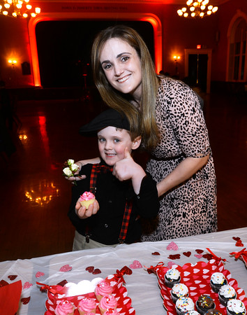 CARL RUSSO/Staff photo Mason Richards, 5 gives the thumbs-up for a date with mom, Crystal Oliver and cupcakes. The annual Valentine's Dance sponsored by Andover's Department of Recreation was held Friday night at the Town House (Old Town Hall) <br /> <br /> The event is held for boys ages 4-10 for moms to celebrate Valentine's Day with the special little guy in their life. <br /> <br /> An evening of dance with music provided by Ted Entertainment DJ, Ted Teichert of Andover was provided along with games, prizes, and refreshments. 2/7/2020.