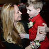 CARL RUSSO/Staff photo Rebecca Lackey pins a flower on her son, Spencer  age 4. The annual Valentine's Dance sponsored by Andover's Department of Recreation was held Friday night at the Town House (Old Town Hall) <br /> <br /> The event is held for boys ages 4-10 for moms to celebrate Valentine's Day with the special little guy in their life. <br /> <br /> An evening of dance with music provided by Ted Entertainment DJ, Ted Teichert of Andover was provided along with games, prizes, and refreshments. 2/7/2020. <br /> <br /> The event is held for boys ages 4-10 for moms to celebrate Valentine's Day with the special little guy in their life. <br /> <br /> An evening of dance with music provided by Ted Entertainment DJ, Ted Teichert of Andover was provided along with games, prizes, and refreshments. 2/7/2020.