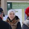 MIKE SPRINGER/Staff photo<br /> Kate Bibeau, engagement manager with the Trustees of the Reservation, visits with guests during the Winter Fun Day on Feb. 17 at the Ward Reservation in Andover.<br /> 2/17/2020