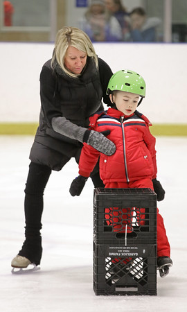 """MIKE SPRINGER/Staff photo<br /> Instructor Leslie Sharrio helps five-year-old Nico Materazzo stay on his feet during an """"It's Great to Skate"""" ice skating clinic Monday at Phillips Academy in Andover.<br /> 2/17/2020"""