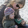MIKE SPRINGER/Staff photo<br /> Catherine Faulk of Andover treats her daughter Abigail, 2, to a hot dog during the Winter Fun Day on Feb. 17 at the Ward Reservation in Andover.<br /> 2/17/2020