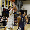 CARL RUSSO/Staff photo Andover captain, Kyle Rocker takes the short jumper over Lawrence captain, Gabriel Zorrilla. Andover defeated Lawrence 66-57 in boys basketball action Friday night. 2/14/2020.