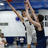 CARL RUSSO/Staff Photo. Lawrence's Jeremiah Melendez, sails to the basket over Andover's Aidan Cammann. Lawrence defeated Andover 60-54 in boys Basketball action in the D1 North tournament. 2/25/2020.