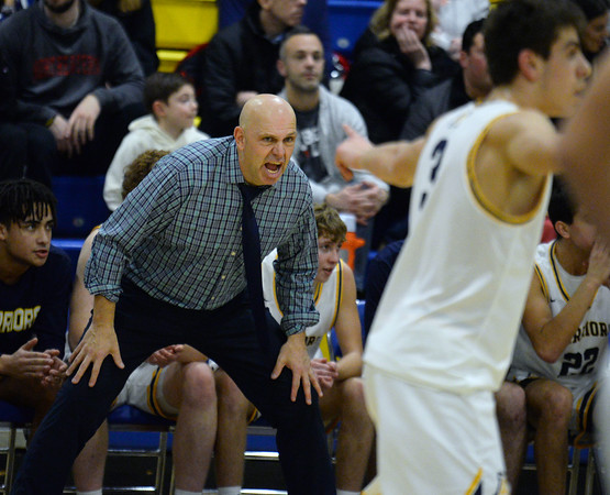 CARL RUSSO/Staff photo Andover's head coach, David Fazio yells  instructions to his players. Andover defeated Lawrence 67-57 in boys basketball action Friday night. 2/14/2020.