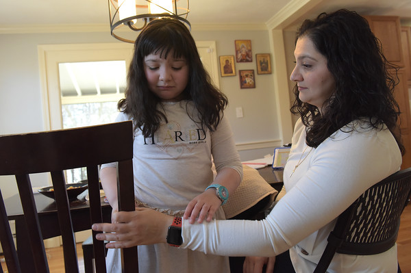 TIM JEAN/Staff photo <br /> <br /> Kyki receives help from her mother Panayiota as she need help moving a chair towards the dinner table before eating lunch.  2/21/20